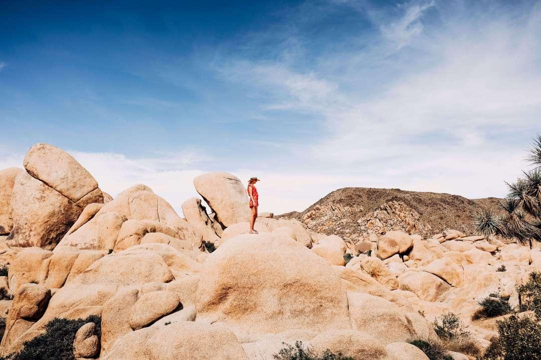 Girl standing on desert rocks