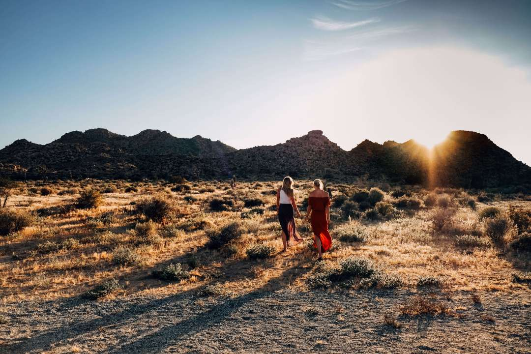 Women walking in desert