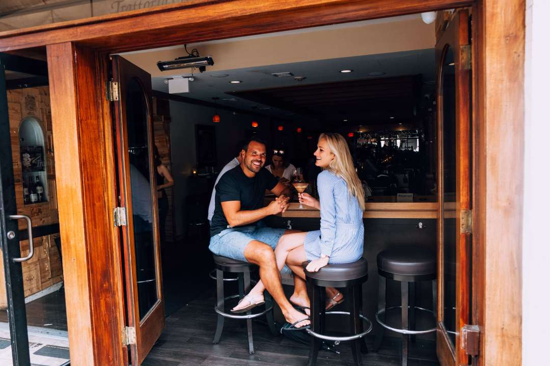 Couple sitting at bar in Boston