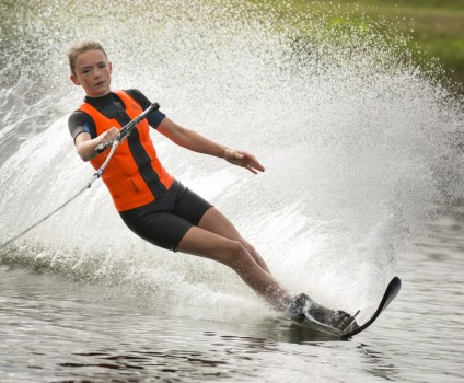Teenagers waterskiing
