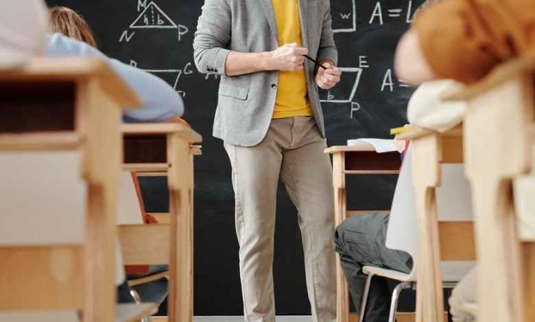 teacher standing in front of a blackboard