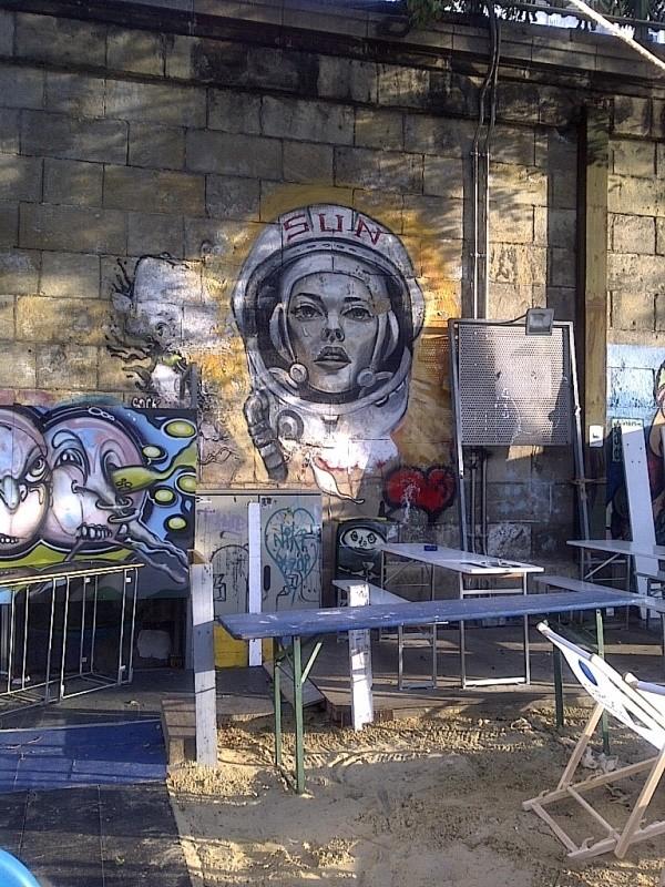 Sun female astronaut, graffiti, Donaukanal, Vienna, Austria, 2014