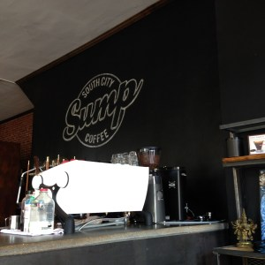 Sump Coffee's matte Slayer sits like a jewel in the dark interior