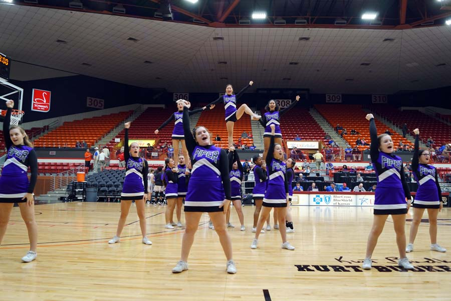 The+Piper+cheer+team+preform+for+the+student+section+during+halftime.