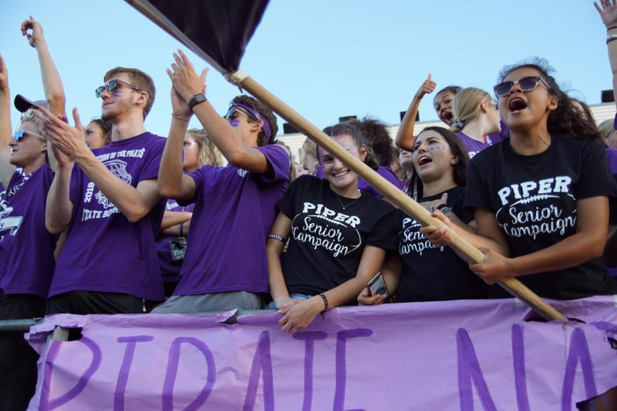 Senior+girls+celebrate+at+the+football+game+against+Eudora+on+Sept.+13.+The+girls+decided+to+start+the+campaign+to+show+more+school+spirit+before+they+graduate.