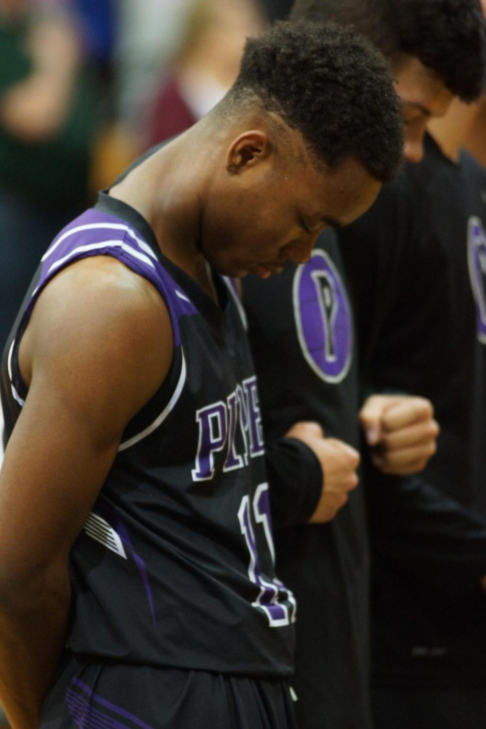 Senior Trey Bates bows his head during the national anthem during last year's sub-state game at Basehor-Linwood