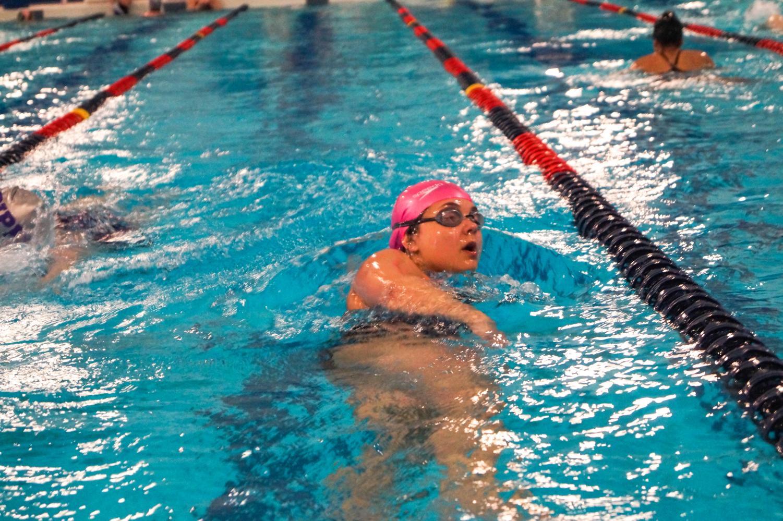 Senior Savannah Vazquez swims at the Lansing varsity meet April 1.