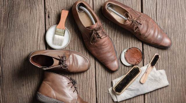 brown leather boots with shoe maintenance set