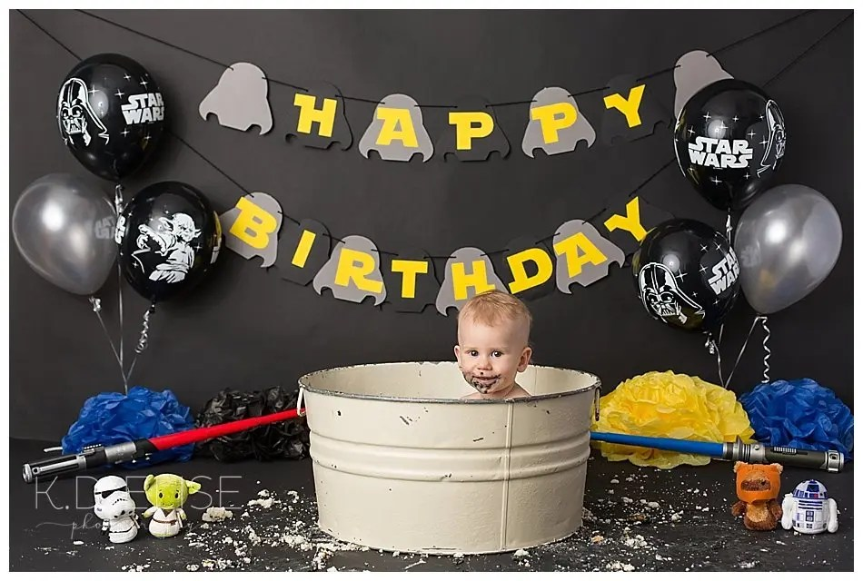 Baby in a bathtub after his Star Wars themed cake smash.
