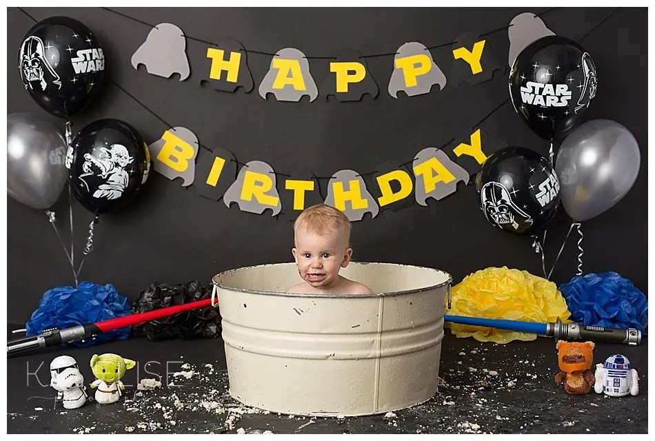 Baby boy in a bathtub after his first birthday Star Wars themed cake smash session.