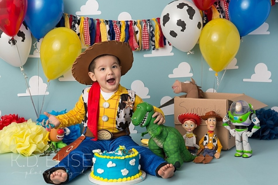 Little boy dressed in Woody costume during his cake smash session with Colorado Springs photographer K.D. Elise Photography.