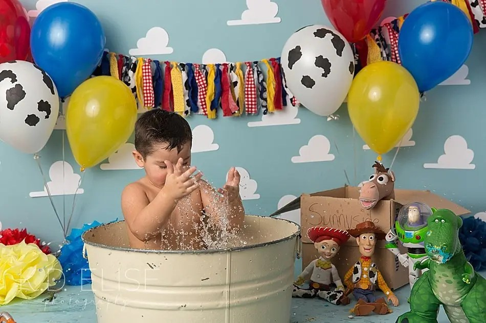 Splashing three year old in a metal wash basin after his Toy Story themed cake smash.