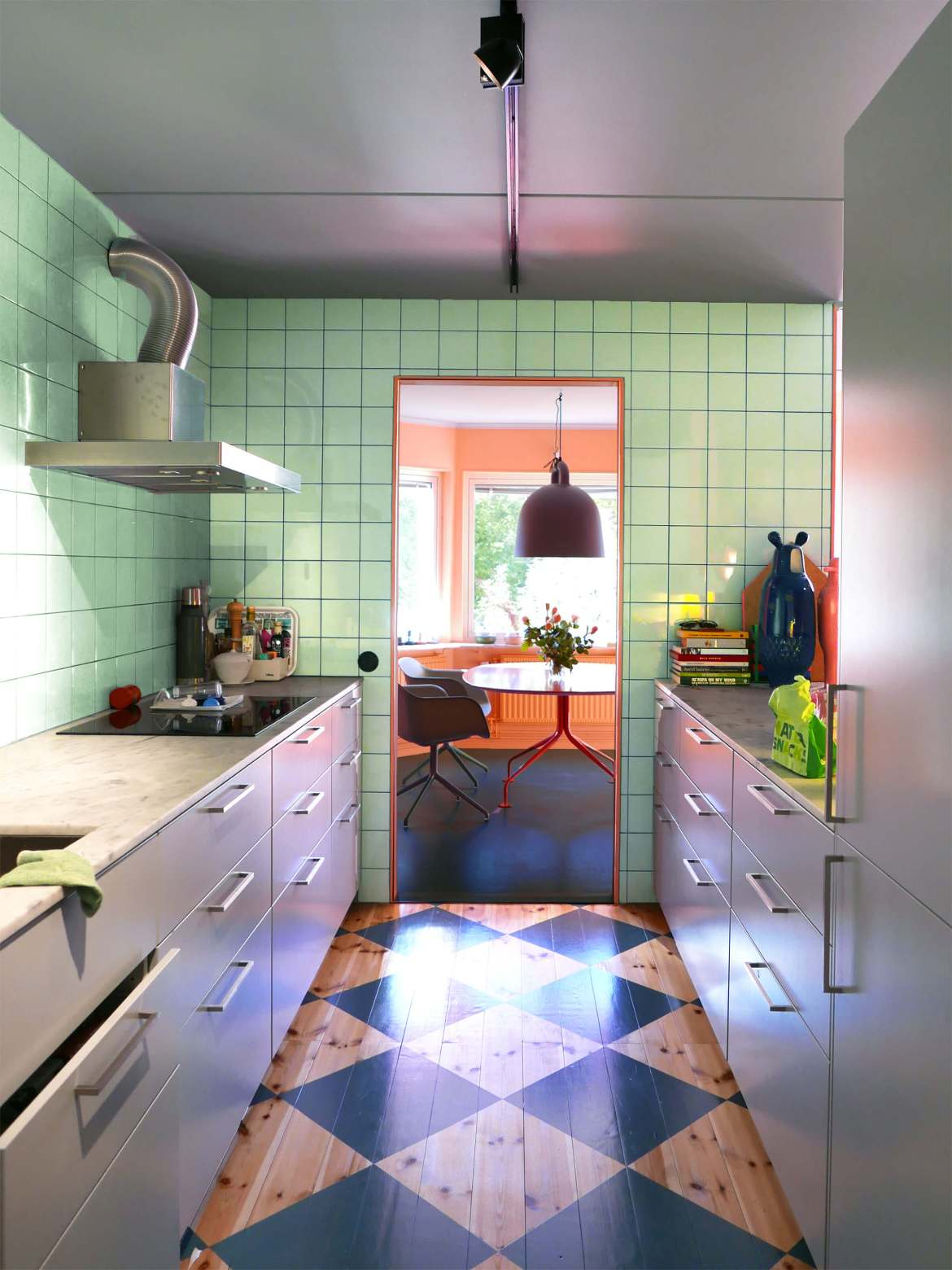 A mint green kitchen and practical cupboards. Image: Tekla Severin