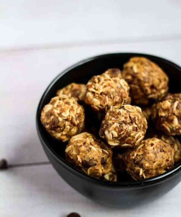 vegan protein balls in black bowl