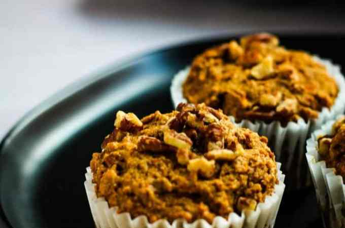 banana carrot muffins on black plate