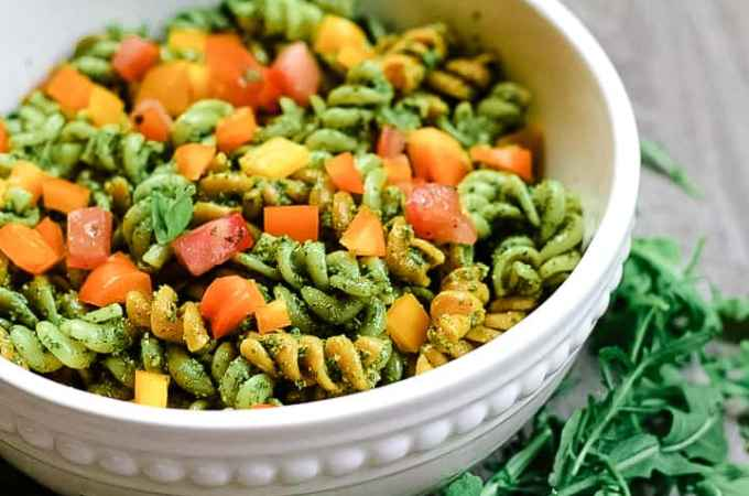 Fresh and peppery, this vegan pesto pasta made with arugula and basil packs a flavorful punch. It's a delicious alternative to the typical white pasta recipes with the substitution of lentil pasta for added protein.