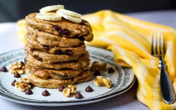vegan whole wheat pancakes on plate with fork