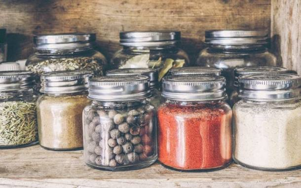 assorted spices in jars for your vegan grocery list