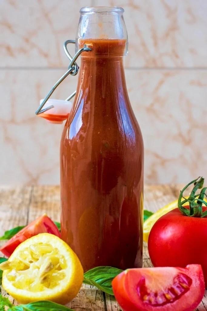 tomato vinaigrette in glass bottle