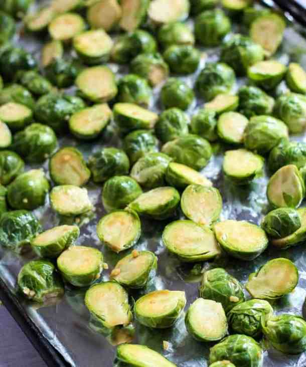 soy sauce brussel sprouts on baking sheet