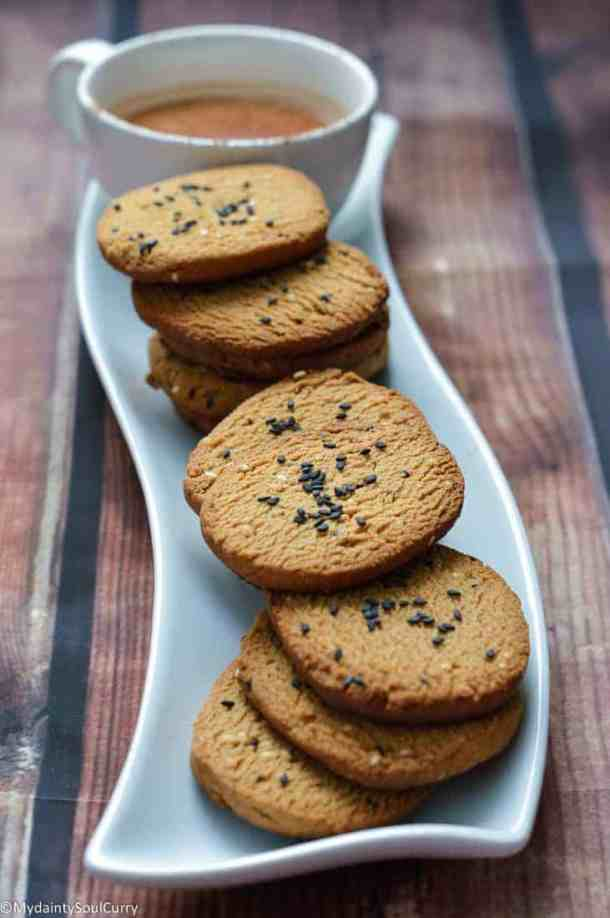 sesame cookies on a white tray