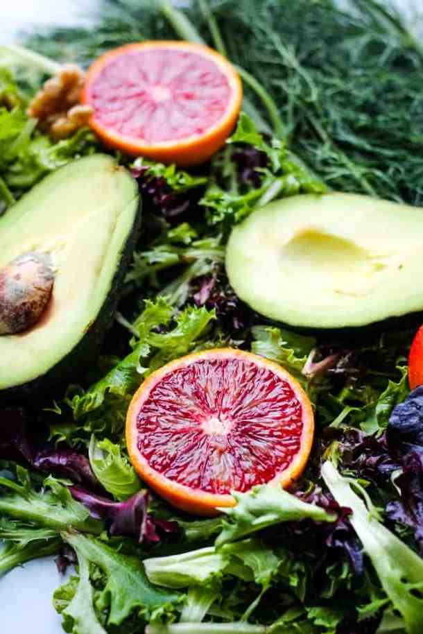 greens, blood oranges, and avocado