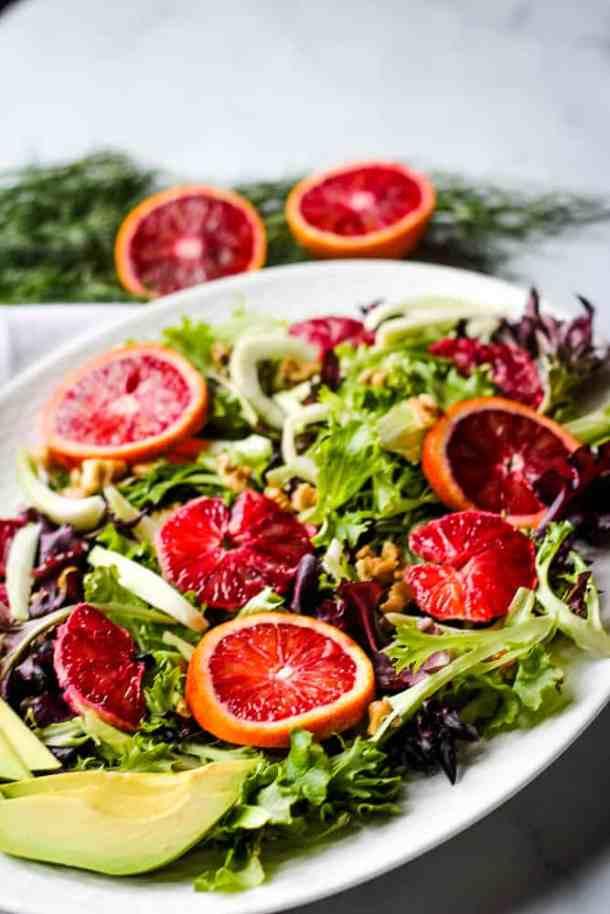 blood orange salad on white platter