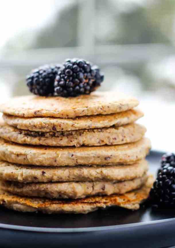 stake of vegan protein pancakes topped with blackberries
