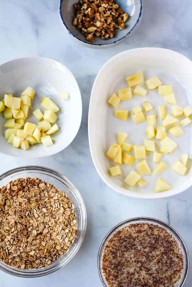 apples, oats, walnuts and flax almond milk on bowls
