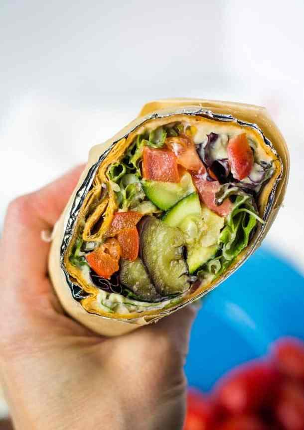 hand holding lavash wrap sandwich