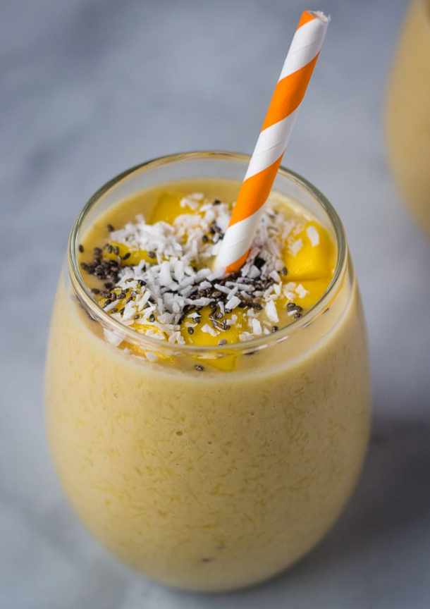 mango banana smoothie in glass cup with chia topping
