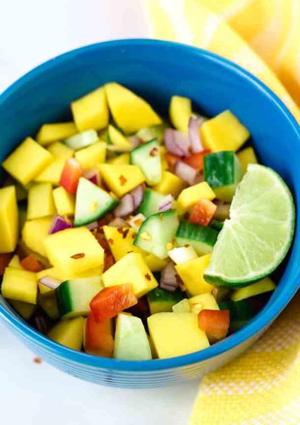 overhead close up mango salad in blue bowl