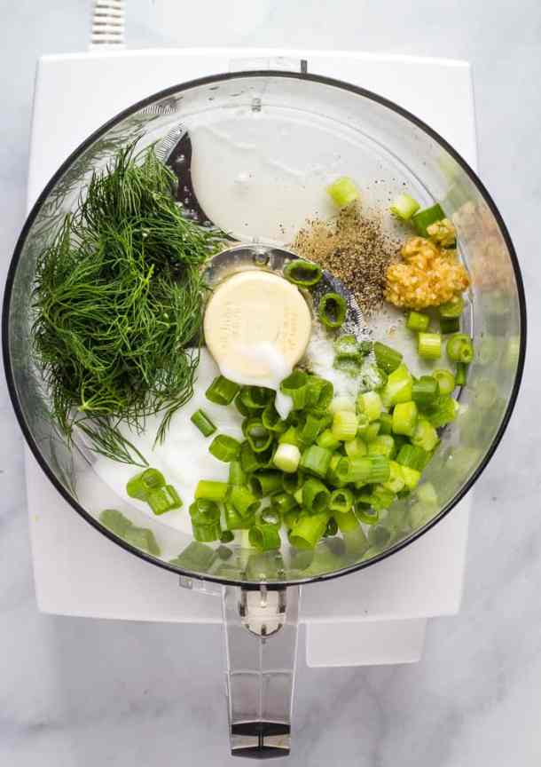 yogurt, herbs, and garlic in food processor
