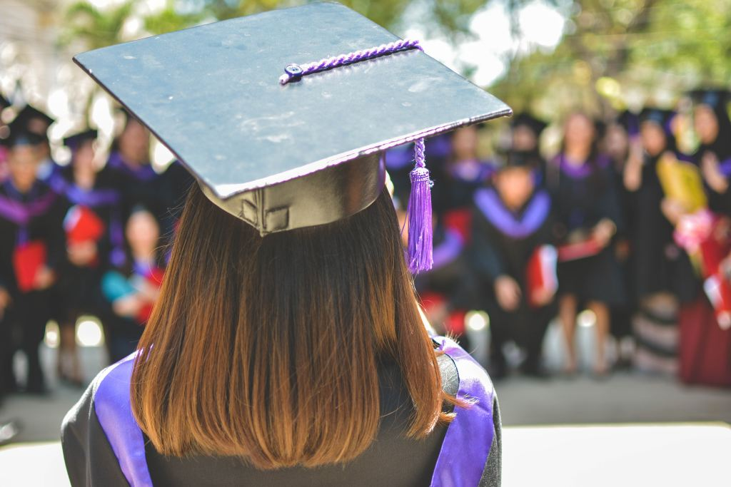 529 plan for MBA: Woman at her MBA graduation