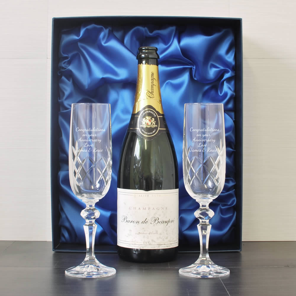 engraved crystal flutes and
