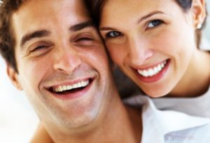 About Us - Husband and wife smiling happily