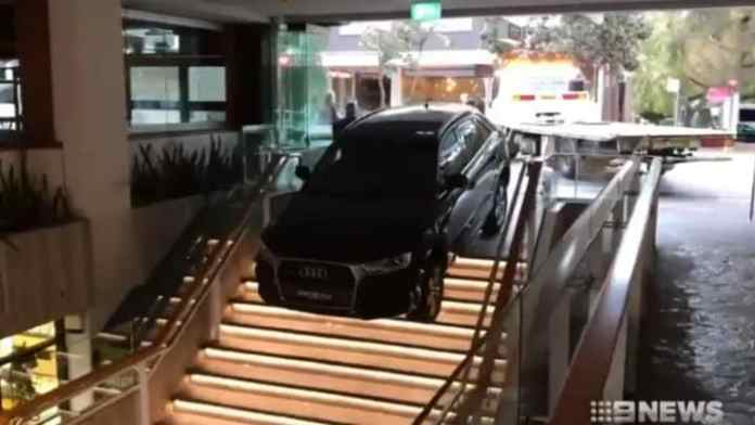 The Uber driver drove off the road and into a staircase in a shopping complex on Hall St, Bondi. Picture: AAPSource:AAP