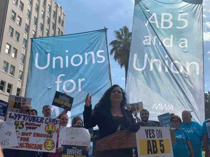 Rideshare drivers protesting against Uber and Lyft after threatening to spend $90 million to stop AB 5.