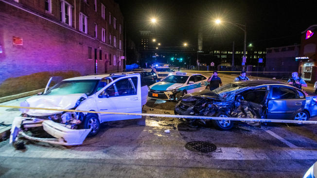 Chicago police investigate the scene of a multi-vehicle crash involving a taxi and four private-use vehicles.