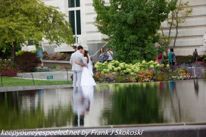 Couple posing for wedding photographs Temple Square