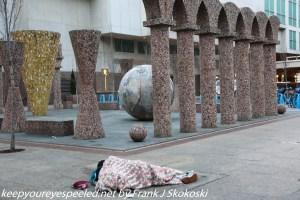homeless person sleeping on frigid street