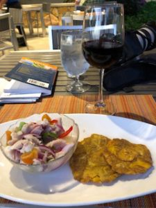 ceviche and monfongo and a glass of wine