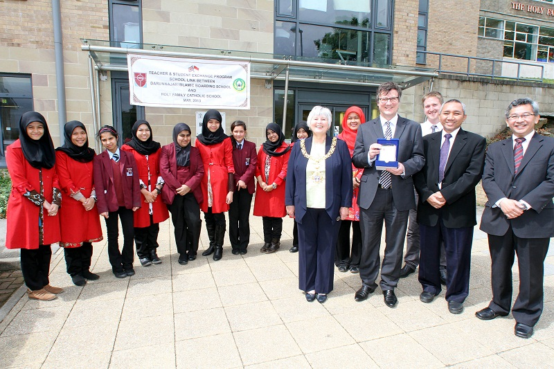 Students from Holy Family School and Darunajah Islamic Boarding School in Jakarta line up with, from left, Keighley Mayor Councillor Sally Walker, teacher Rizma Ilfi, Holy Family head teacher Lawrence Bentley, Kevin Quinn, of the British Council, principa