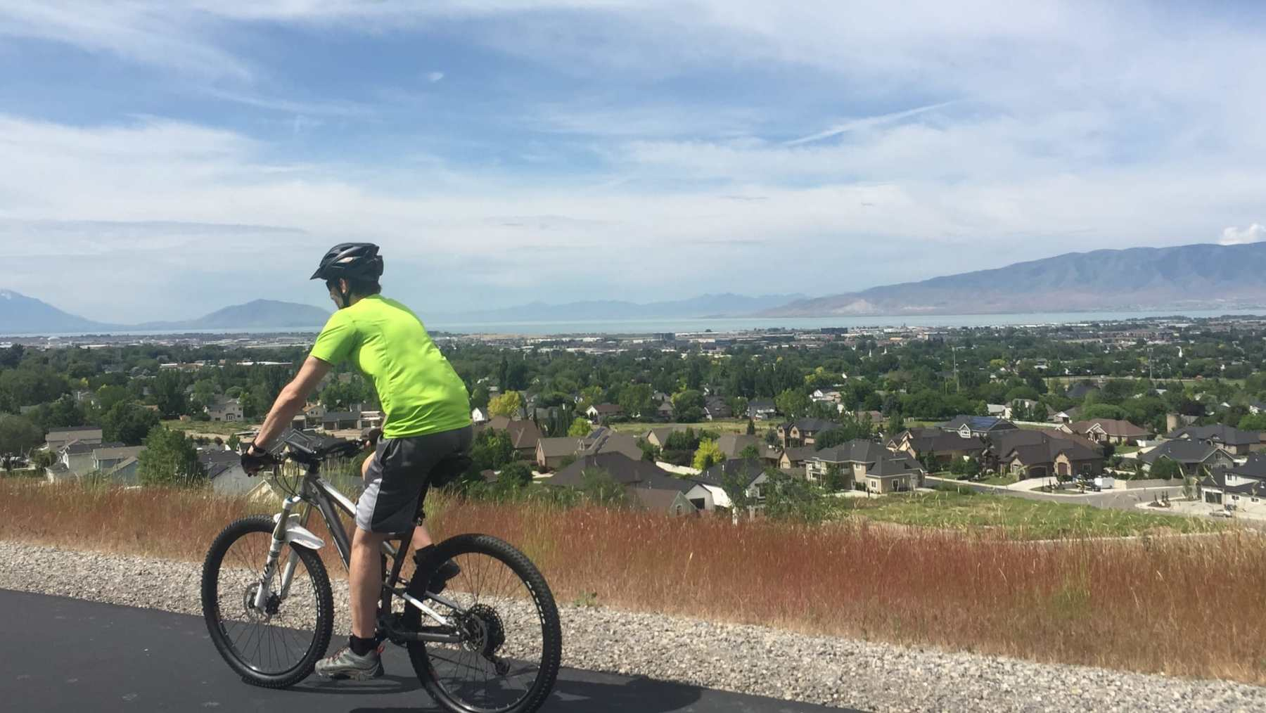 using his mountain bike to ride on the bike path for PT