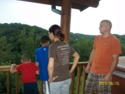 Family Looking out over Cabin rail
