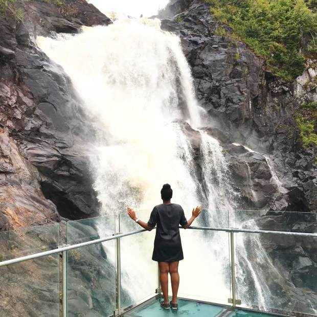 one person standing in front of Ouiatchouan Falls