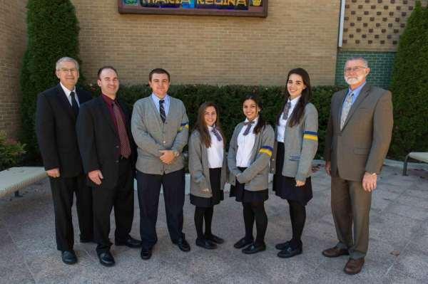 Pictured from left to right: Bro. Kenneth M. Hoagland, S.M., Mr. Sean Vegas, Donato Moneta, Jacuqeline, Alexa, Courtney, Mr. Clark