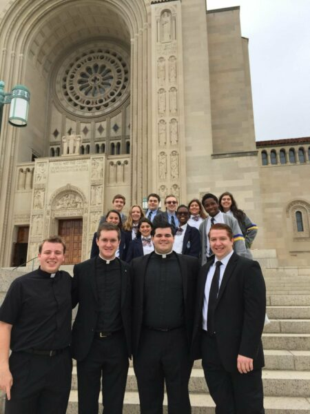 Kellenberg alumni Paul Clores '11, John Crozier '11, Matt Browne '11, Kieran Maelia '13 meet up with Kellenberg students on the diocesan pilgrimage to the National Basilica Shrine.