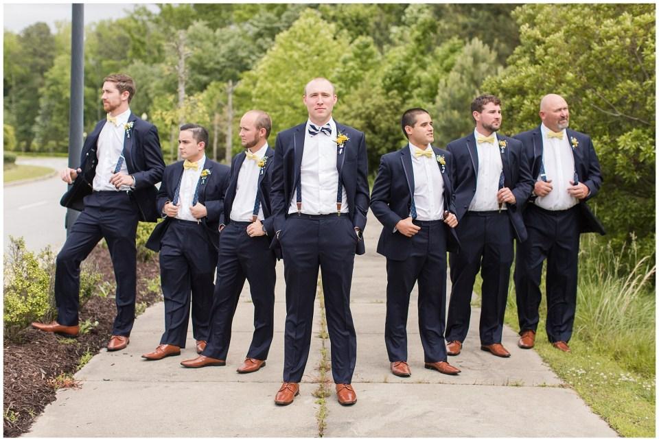 groom and groomsmen wearing suspenders