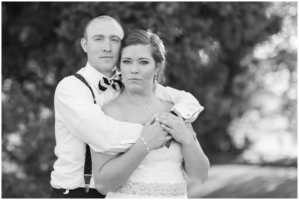 bride and groom no smiles black and white portrait